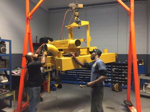 Myers-Seth Pumps Employees Working on a Pump